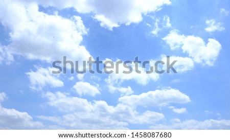 Beautiful sky with clouds background.Sky clouds.Sky with clouds weather nature cloud blue.Blue sky with clouds and sun. #1458087680