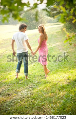 Young romantic couple in love in the nature #1458177023