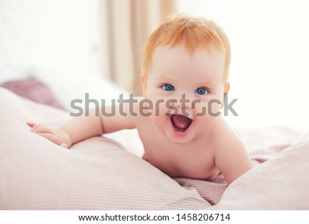 happy excited infant baby girl crawling on the bed #1458206714