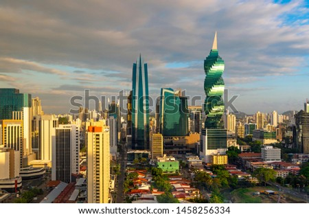 The colorful panoramic skyline of Panama City at sunset with high rise skyscrapers, Panama, Central America. #1458256334