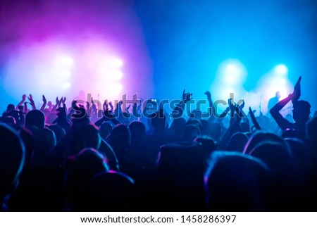 silhouettes of audience at rock concert #1458286397