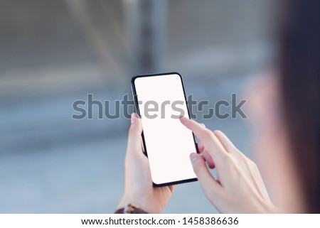 Hand holding smartphone blank screen on isolated. Take your screen to put on advertising.  #1458386636