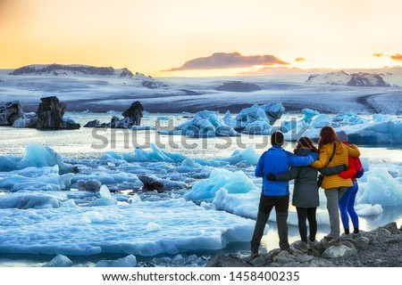 Group of tourist looking Beautifull landscape with floating icebergs in Jokulsarlon glacier lagoon at sunset. Location: Jokulsarlon glacial lagoon, Vatnajokull National Park, south Iceland, Europe #1458400235