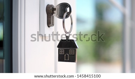 The house key for unlocking a new house is plugged into the door.        Royalty-Free Stock Photo #1458415100