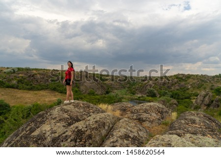 Large granite canyon. Village Aktove. Ukraine. Beautiful stone landscape. Woman 35 years old brunette tourist on the canyon #1458620564