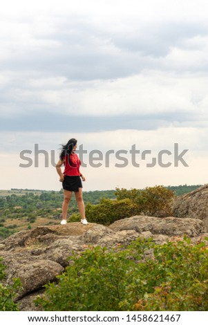 Large granite canyon. Village Aktove. Ukraine. Beautiful stone landscape. Woman 35 years old brunette tourist on the canyon #1458621467