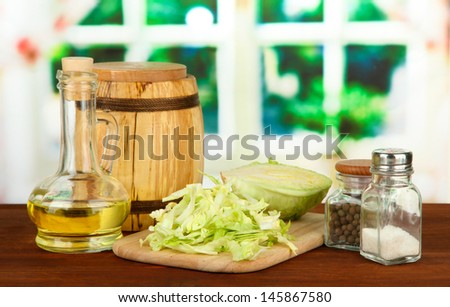 Green cabbage, oil, spices on cutting board, on bright background #145867580