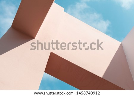 Abstract modern architecture fragment, background photo of a pink facade structures under blue sky at sunny day #1458740912