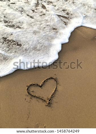 Drawn heart on the sand , sea shore #1458764249
