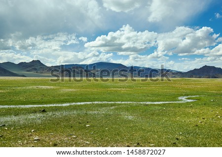 Mongolian Altai.  Scenic valley on the background of the snowcapped mountains. #1458872027