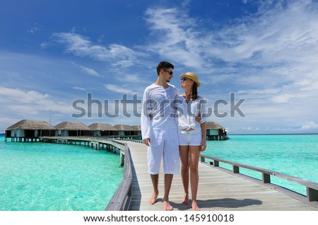 Couple on a tropical beach jetty at Maldives #145910018