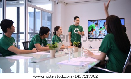 Participation concept. Company employees help to do activities to reduce waste for society. #1459119902