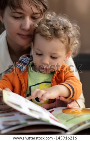 Mother and her toddler choosing dish in a cafe #145916216