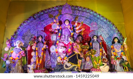 Durga Puja or Durgotsava,is an annual Hindu festival celebrated mainly in West Bengal,India.Durga is Goddess riding a lion with many arms each carrying weapon and defeating evil power of Mahishasura. #1459225049