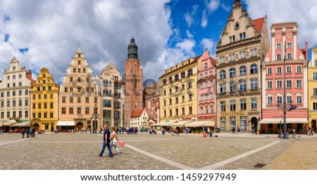 WROCLAW, POLAND - July 17, 2019: Market Square in Wroclaw Old Town. Wroclaw is a historical capital of Lower Silesia, city with one of the bigest Market squares in Europe. #1459297949