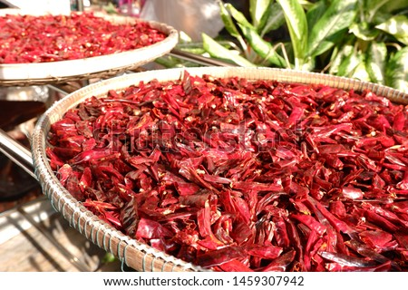 Dried red hot chilies in the bamboo basket on Cement floor #1459307942