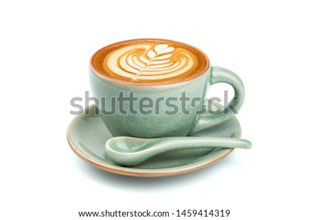 Side view of hot latte coffee with latte art in a ceramic green cup and saucer isolated on white background with clipping path inside. Image stacking techniques. #1459414319