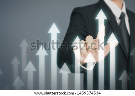 Businessman Hand Touching stock Graph Indicating Growth #1459574534