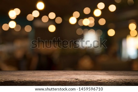 Empty wood table top on blur light gold bokeh of cafe restaurant in dark background #1459596710