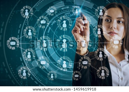 Attractive young european businesswoman using creative social network interface on blurry dark background. Media, HR and internet concept. Double exposure #1459619918