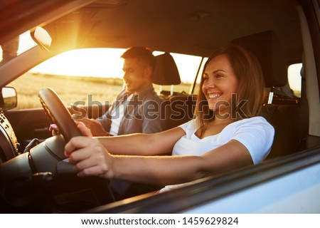 Smiling woman driving a car  #1459629824