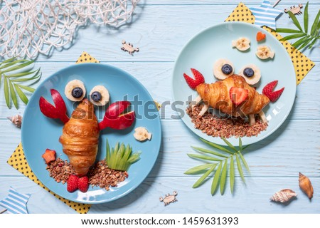 Fun Food for kids. Cute crab and lobster croissants with fruit for kids breakfast #1459631393