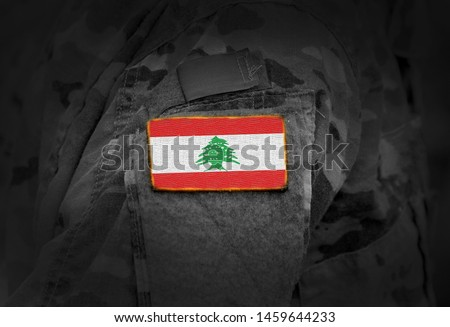 Flag of Lebanon on soldiers arm (collage). #1459644233