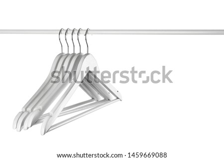 Rack with clothes hangers on white background #1459669088