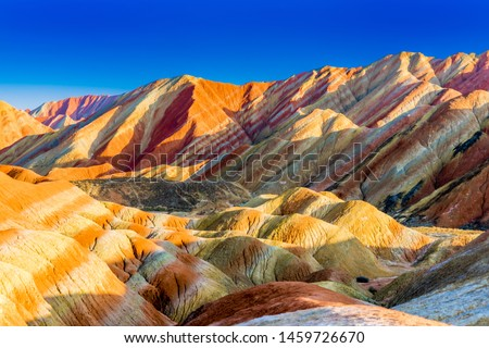 Amazing scenery of Rainbow mountain and blue sky background in sunset. Zhangye Danxia National Geopark, Gansu, China. Colorful landscape, rainbow hills, unusual colored rocks, sandstone erosion #1459726670