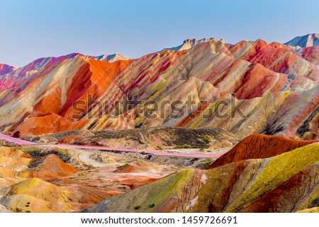 Amazing scenery of Rainbow mountain and blue sky background in sunset. Zhangye Danxia National Geopark, Gansu, China. Colorful landscape, rainbow hills, unusual colored rocks, sandstone erosion #1459726691