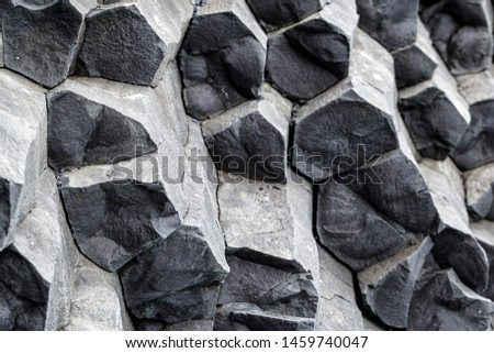 Natural stone texture. Basalt lava formations like columns. Icelandic typical natural background. Reynisfjara Beach Volcanic Basalt Coloumn Formations in Iceland. Royalty-Free Stock Photo #1459740047