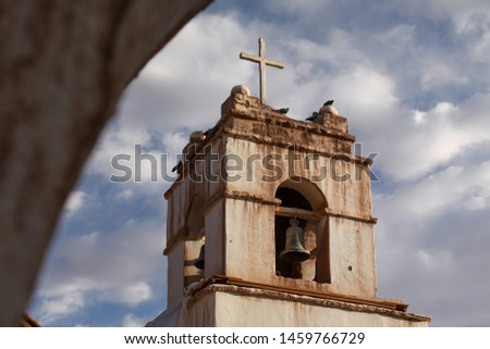View of dirty church tower with bell and cross #1459766729