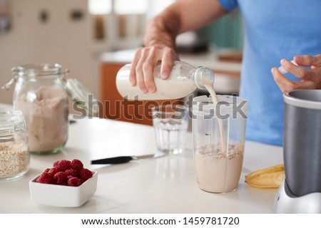 Close Up Of Man Making Protein Shake After Exercise At Home #1459781720