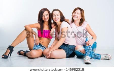 teenage girls smiling on light background #145982318