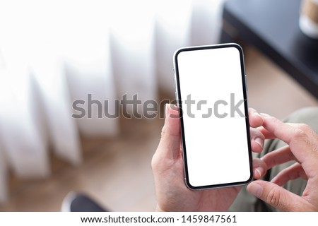 Mockup image screen cell phone.women hand holding texting using mobile at desk in office.with white blank space for advertise text.concept for contact business,people communication,technology device #1459847561