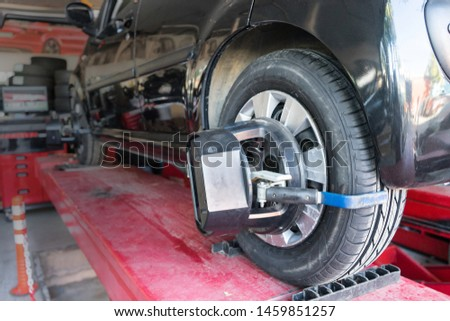 Tyre / tire fitting, rod adjustment. For the vehicle on the adjusting the tie-rod to align the wheel correctly. #1459851257