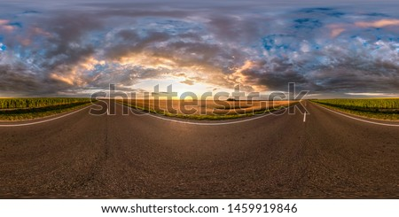 full seamless spherical hdri panorama 360 degrees angle view on asphalt road among fields in summer evening sunset with awesome clouds in equirectangular projection, ready for VR AR virtual reality
