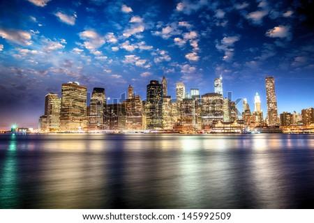 Spectacular sunset view of lower Manhattan skyline from Brooklyn Bridge Park.