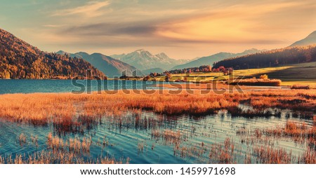Incredible Nature Landscape. Colorful sky Resia Lake in Dolomites mountains, during sunrise. Scenic image of Stunning nature in Dolomites alps. Amazing Autumn Landscape. Natural background. #1459971698