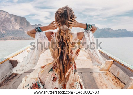 fashionable young model in boho style dress on boat at the lake  #1460001983