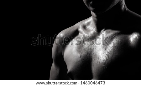 Asian Big Muscle Fitness Man exercise show arms, bicep, chest with sweat from heat. Young Sport Male six packs shoot in low key lighting exposure with shadow contrast, copy space #1460046473