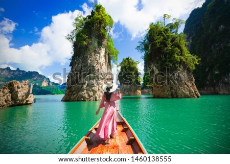 Asian woman posing on boat in Ratchaprapha dam Khao sok national park at suratthani,Thailand #1460138555