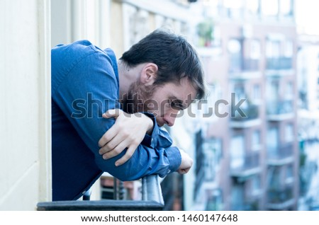 Lonely sad man staring outside house balcony feeling depressed distress and miserable. Suffering emotional crisis thinking about difficult important life decision In Men Depression and mental health. #1460147648