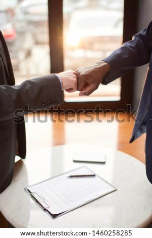 Two businessmen having a meeting in the cafe. #1460258285