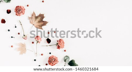 Autumn creative composition. Pattern made of dried autumn leaves, berries, flowers on white background. Fall background. Flat lay, top view, copy space #1460321684