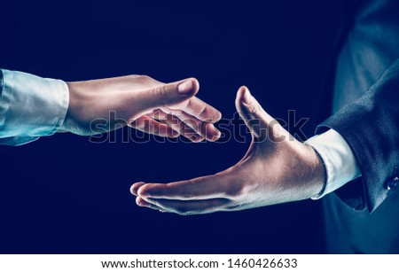 concept of partnership in business:two businessmen stretches his #1460426633