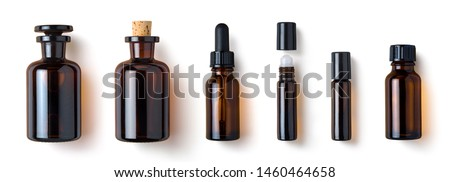 various amber glass bottles for cosmetics, natural medicine , essential oils or other liquids isolated on a white background, top view	 #1460464658
