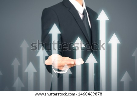 Businessman Hand Touching stock Graph Indicating Growth #1460469878