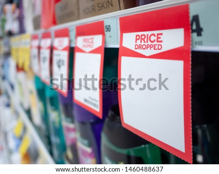 Mock up template of paper tag shows price dropped with blank space for text on supermarket shelf. Royalty-Free Stock Photo #1460488637