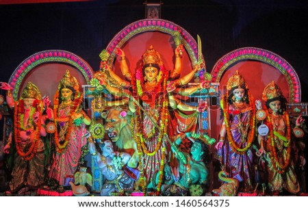 Durga Puja or Durgotsava,is an annual Hindu festival celebrated mainly in West Bengal,India.Durga is Goddess riding a lion with many arms each carrying weapon and defeating evil power of Mahishasura. #1460564375